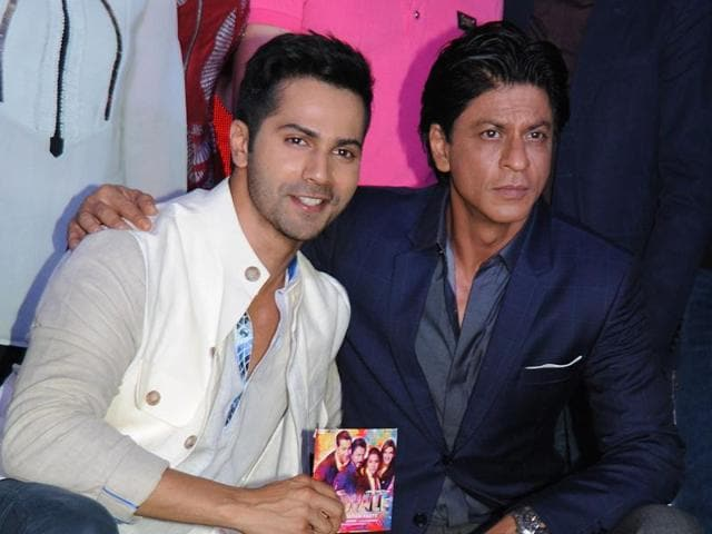 Varun Dhawan and Shah Rukh Khan pose during the music celebration of the Dilwale in Mumbai.