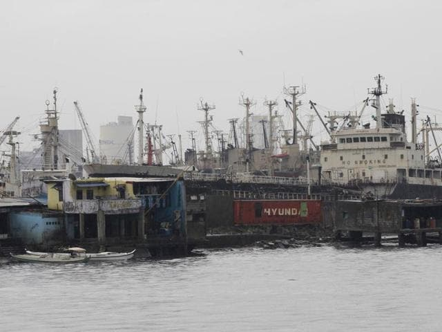 Cargo vessels are docked at the north harbor in Navotas city, north of Manila, after Philippine Coastguard prohibited vessels from sailing due to heavy current and winds brought by Typhoon Melor.