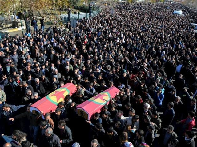 Mourners carry the coffins of Serdil Cengiz and Siyar Salman who were killed in a bomb blast in Diyarbakir.