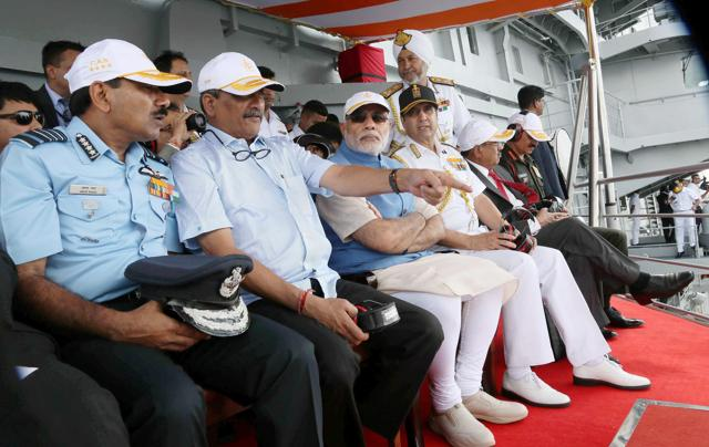 Prime Minister Narendra Modi, flanked by Union Minister for Defence, Manohar Parrikar, the Chief of the Air Staff, Air Chief Marshal Arup Raha, the Chief of Army Staff, General Dalbir Singh and the Chief of Naval Staff, Admiral R.K. Dhowan, witnessing the operational demonstrations at INS Vikramaditya, in Kochi.