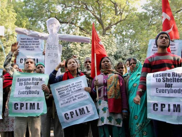 People carry an effigy of Railway Minister Suresh Prabhu during a protest over the demolition of a Shakur Basti slum, at Jantar Mantar in New Delhi on Tuesday.
