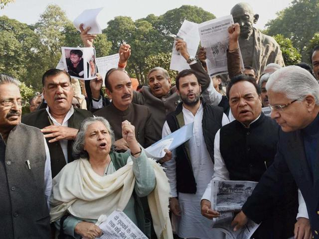 Congress vice president Rahul Gandhi shouts slogans with party MPs at protest in front of Mahatma Gandhi's statue at Parliament in New Delhi on Monday. The hope of an agreement on the GST bill dimmed by the deadlock between the government and the opposition.
