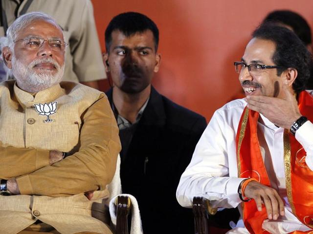 To oppose Prime Minister Narendra Modi's (left) pet scheme, the Uddhav Thackeray-led Shiv Sena has brandished its pet theory which it has used in the past: it is a controversy to make Mumbai a union territory.