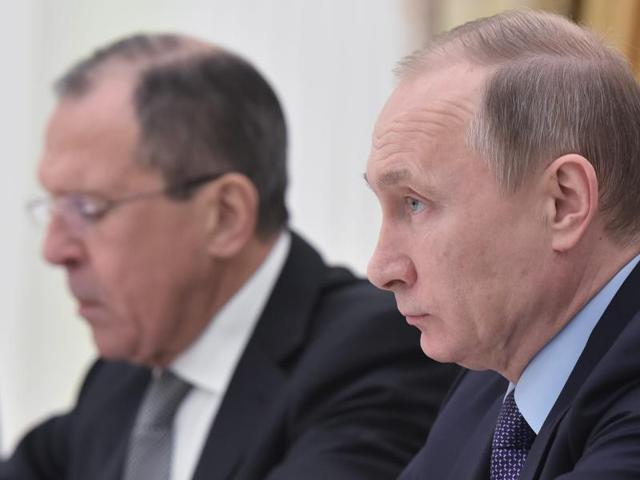 Russia's president Vladimir Putin (R) and Russia's Foreign minister Sergei Lavrov take part in a meeting with US Secretary of State and US Ambassador in Russia at the Kremlin in Moscow.