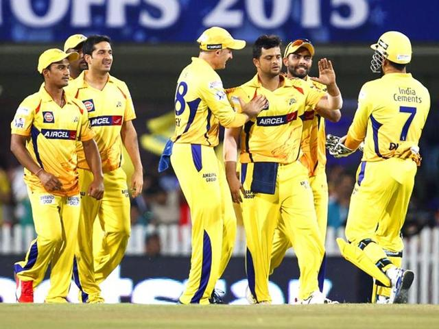 Suresh Raina celebrates with teammates after taking the wicket of Royal Challengers Bangalore's Chris Gayle during their Indian Premier League (IPL) 2015 Qualifier 2 match in Ranchi on May 22.