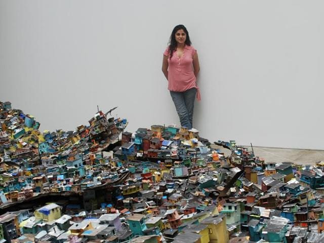 A Dharavi-themed installation where Hema Upadhyay created an aerial view of the Mumbai slum on a gallery floor using tin cans, plastic and aluminum sheets.