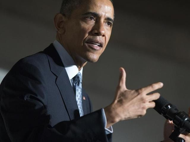 US President Barack Obama speaks during the naturalisation ceremony at the National Archives Museum in Washington.