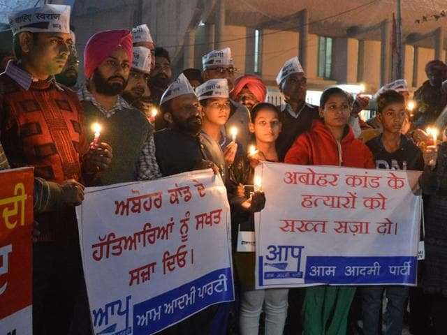 Members of AAP holding candlelight vigil at Aatri Chowk in Ludhiana on Wednesday.