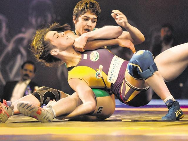 Liliya Horishna (Blue) and UP warrior Babita Kumari (yellow) in action during match pro wrestling league at Guru Nanak Stadium in Ludhiana on December15, 2015.