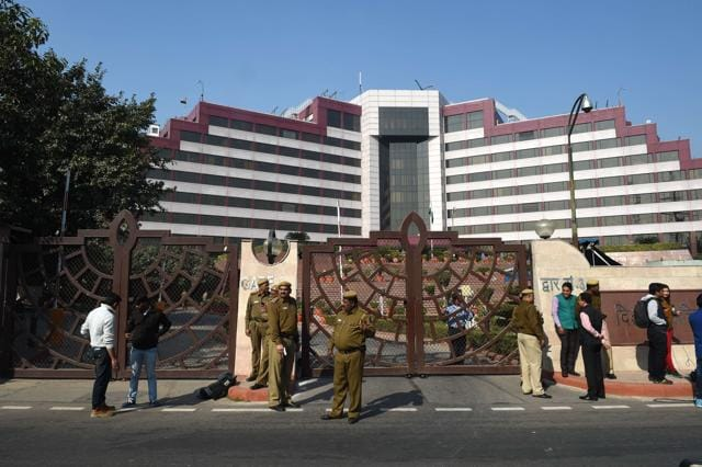 P stand guard outside the Delhi Secretariat in New Delhi on December 15, 2015. Delhi's chief minister Arvind Kejriwal accused  Narendra Modi of waging a