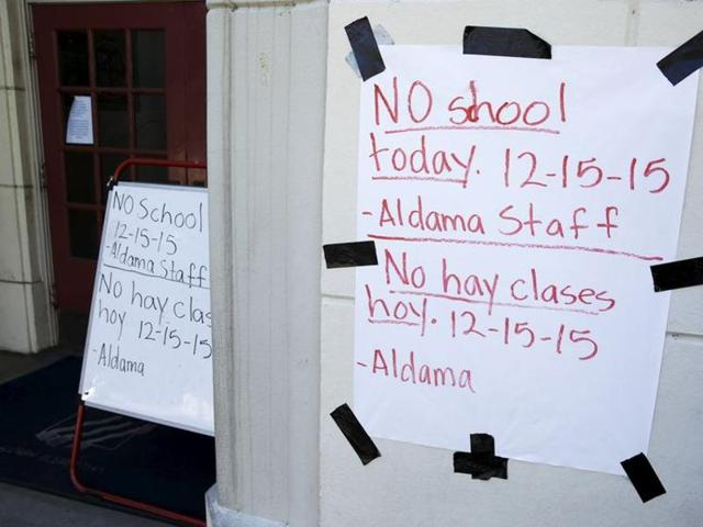 """A sign announcing no school is pictured at Aldama Elementary School in the Highland Park neighborhood of Los Angeles, California December 15, 2015. The drastic decision on Tuesday to close more than 900 schools and to keep 640,000 students at home was made out of """"an abundance of caution,"""" and in light of the deadly December 2 attacks in nearby San Bernardino."""