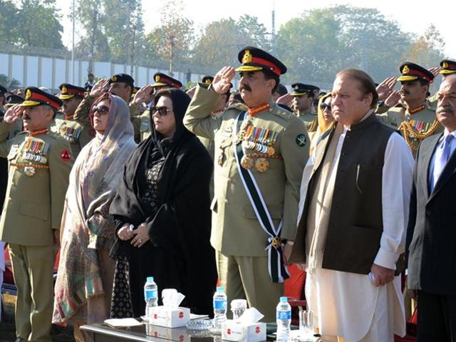 Pakistan's Prime Minister Nawaz Sharif (2R) and army chief Raheel Sharif (C) paying their respects during a ceremony to mark the first anniversary of the Peshawar school massacre which left more than 150 people dead.