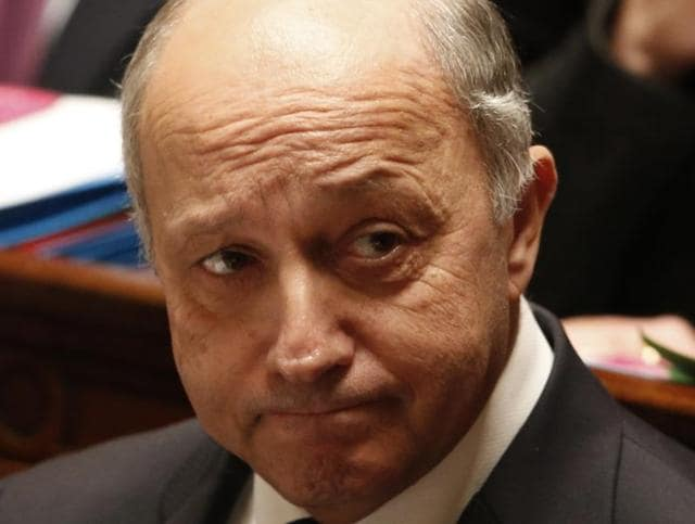 French Foreign Minister Laurent Fabius reacts during the questions to the government session at the National Assembly in Paris, France, December 15, 2015.