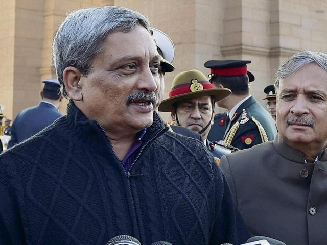 Defence minister Manohar Parrikar with MoS for defence Rao Inderjit Singh and Army chief General Dalbir Singh addresses the media after paying homage at Amar Jawan Jyoti on the anniversary of 'Vijay Diwas' in New Delhi.