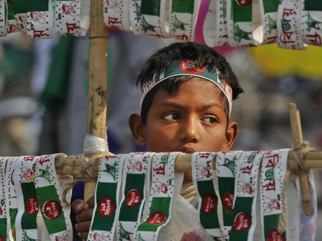 A child sells headbands during the Victory Day celebrations. Bangladesh observed its Victory Day on Wednesday to mark the defeat of Pakistan in 1971, when the country became independent after a nine-month war, against the backdrop of calls for Dhaka to cut ties with Islamabad for its denial of the genocide during the hostilities.