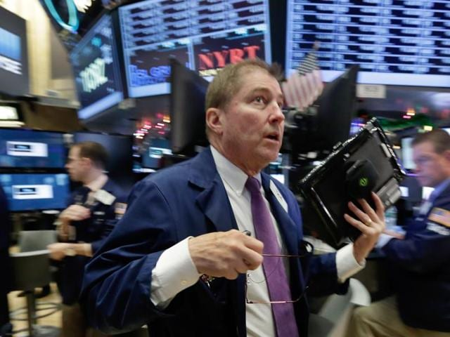 A trader rushes across the floor of the New York Stock Exchange on Wednesday.
