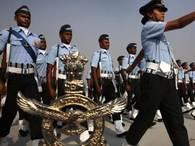 Indian Air Force women officers lead a marching contingent during the Indian Air Force Day parade at Hindon Air Force.