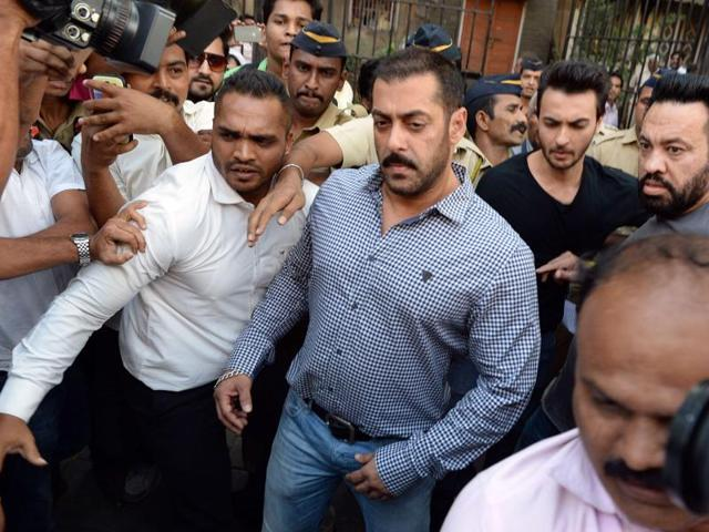 """Bollywood actor Salman Khan (C) walks from Bombay High Court in Mumbai on December 10, 2015, after being acquitted of culpable homicide. In his final judgement, Justice AR Joshi commented that the trial court did not appreciate the evidence related to the case in a """"proper and legal"""" manner."""