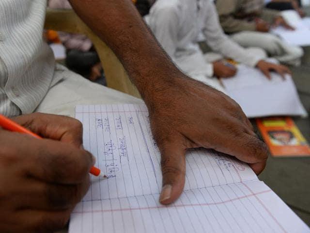 Participants attend a Sanskrit class at the Sanskrit Samvadshala on the outskirts of New Delhi.
