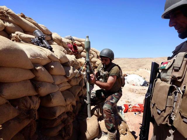 Two Iraqi volunteers were killed when Islamic State jihadists attacked Bashiqa camp on Wednesday.