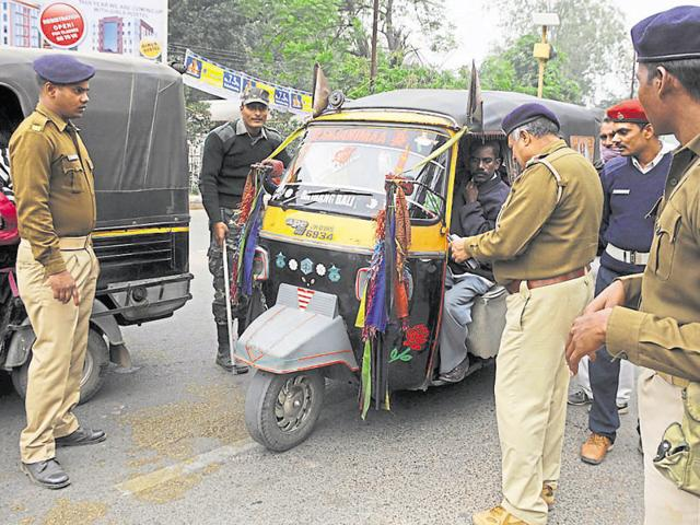 Traffic police personnel checking road permits of diesel-run auto-rickshaws near chief minister's residence in Ranchi on Thursday.