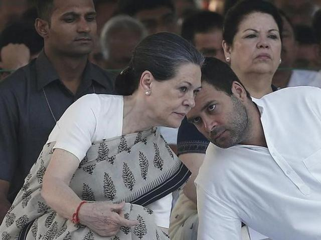 Congress party chief Sonia Gandhi listens to her son Rahul Gandhi , at Rajiv Gandhi's memorial, on the occasion of his 23rd death anniversary, in New Delhi.