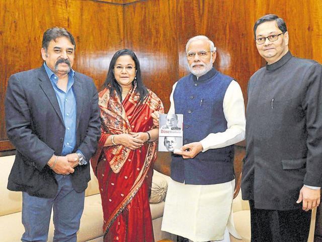 The grand-niece and grand-nephew of Netaji Subhas Chandra Bose with PM Narendra Modi in New Delhi on Wednesday.