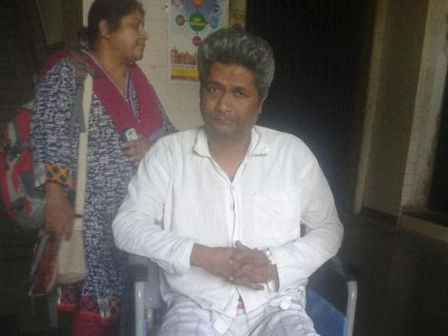 Motorman Shrikant Balkrishna Kotuwar suffered injuries to his chest after an iron sheet fell shattered the front glass in the motorman's cabin on Thursday.