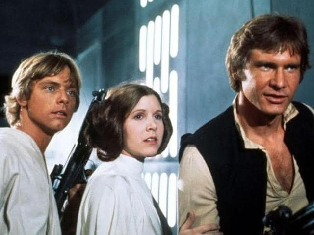 Mark Hamill, Carrie Fischer and Harrison Ford in a still from Star Wars: A New Hope.