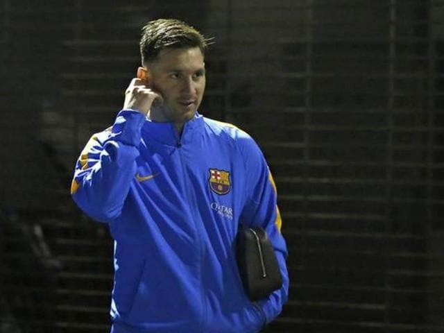 A file photo ofSpain's Barcelona forward Lionel Messi attends a football practice session in Yokohama, a suburb of Tokyo.