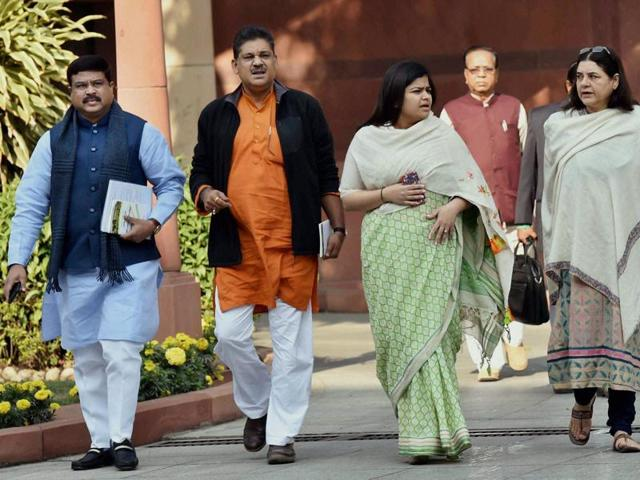 Petroleum Minister Dharmendra Pradhan with Union Women and Child Welfare Minister Maneka Gandhi and BJP leaders Kirti Azad and Poonam Mahajan after the BJP parliamentary board meeting in New Delhi