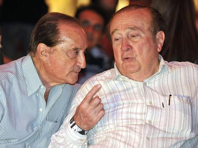 A file photo of South American Football Confederation vice-president Eugenio Figueredo  and president Nicolas Leoz chat during the presentation of the new Paraguayan national football team kit for the 2011 Copa America .