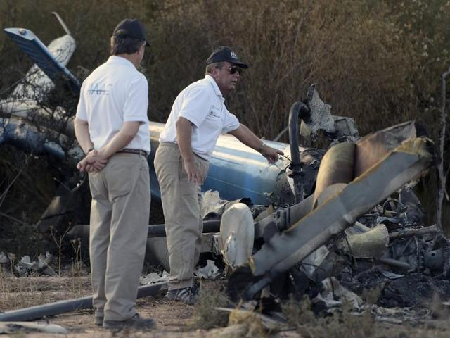 Members of the joint investigation of civil aviation accidents inspect the wreckage of the helicopter which collided mid-air near Villa Castelli in the Argentine province of La Rioja in March, 2015. Investigators on Thursday revealed that pilot error caused the twin helicopter crash.