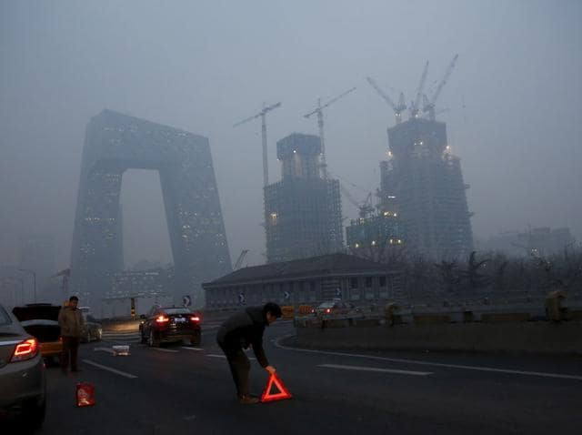 """Bouts of acrid smog enveloping Beijing prompted authorities in the Chinese capital to declare two unprecedented """"red alerts"""" this month - a warning to the city's 22 million inhabitants that heavy pollution is expected for more than three days."""