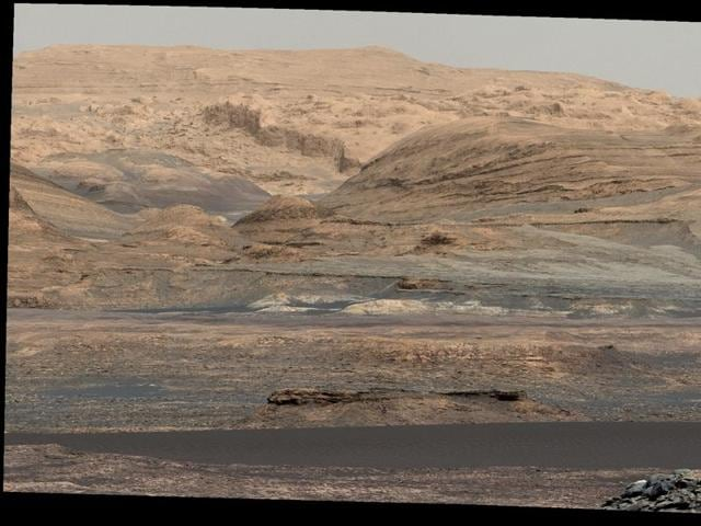 In an undated handout photo, a color-adjusted composite of images taken by NASA's Curiosity rover in September that shows the lower portion of Mount Sharp, which has been studied for the past 15 months.