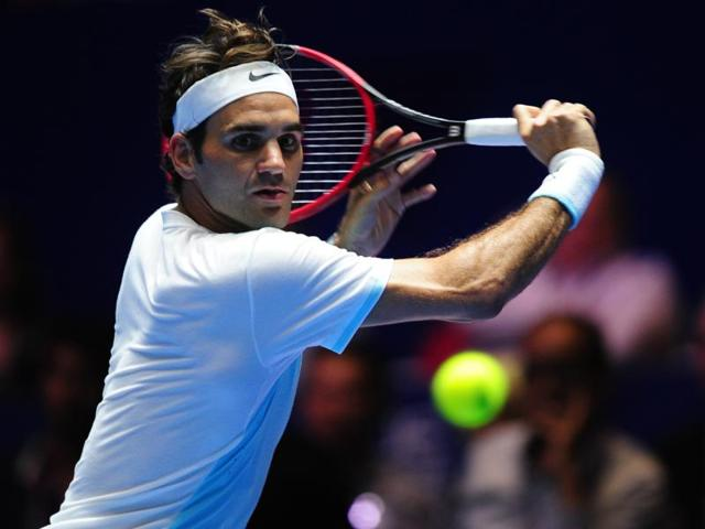 Switzerland's Roger Federer of Obi UAE Royals hits a return against Switzerland's Stan Wawrinka of OUE Singapore Slammers during their men's singles match at the International Premier Tennis League (IPTL).