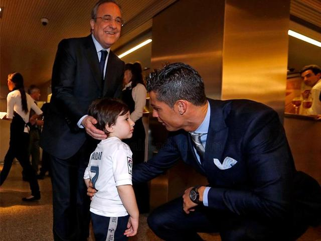Ronaldo, wearing a suit and tie, could be seen in a picture posted on the club website giving the boy a hug.
