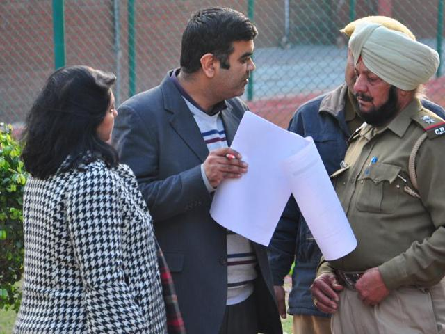 After being denied the submission of their child's form, a couple complaining to cops at Carmel Convent School, Sector 9, Chandigarh, on Friday.