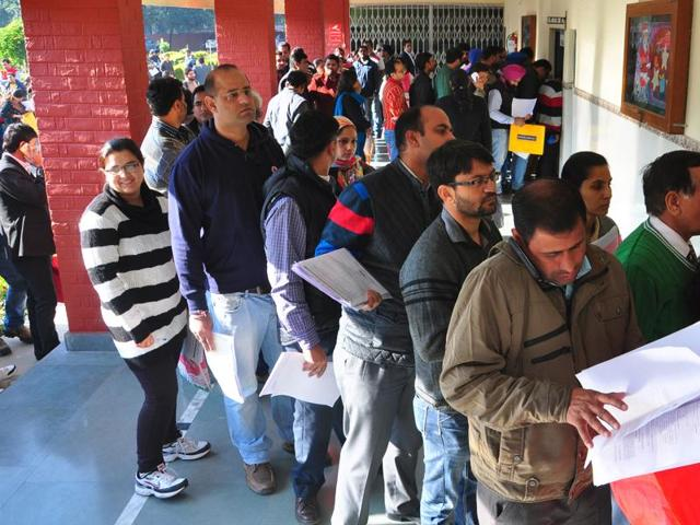 Parents submitting admission forms at Sacred Heart School in Sector 26, Chandigarh, on Friday.