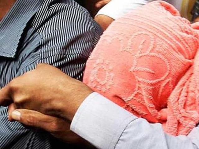 The juvenile accused in the December16 gang-rape and murder of paramedical student, is escorted after he was produced before the Juvenile Justice Board in New Delhi on August 31. (PTI File Photo)