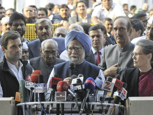 Former PM Manmohan Singh with Congress president Sonia Gandhi and vice-president Rahul Gandhi interact with journalists at AICC office.