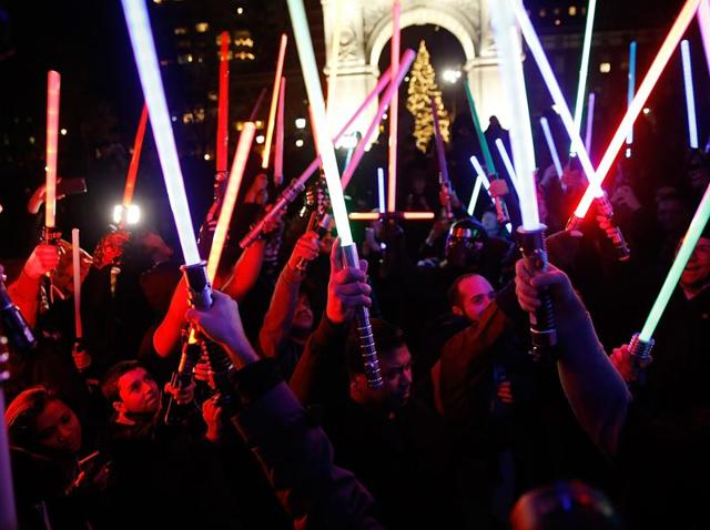 Fans participate in the Star Wars Lightsaber Battle The Light Battle Tour at Washington Square Park on December 18, 2015 in New York City.