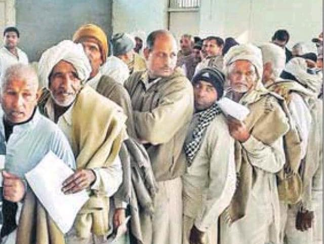 Farmers line up at the Gohana tehsil office to offer their land for acquisition on Saturday.