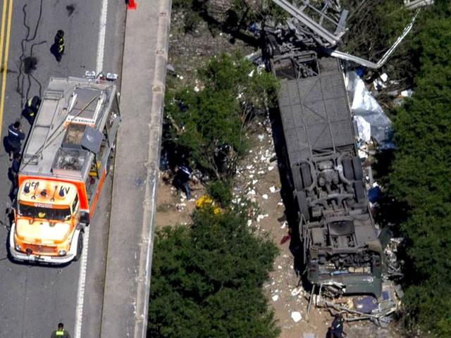 13 people including ethnic Chinese Malaysian tourists were killed Sunday when a bus plunged off a road in Thailand.