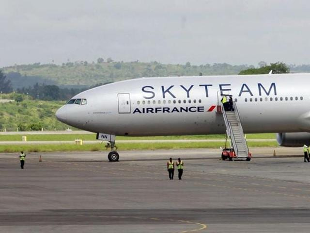 Airport workers are seen near the Air France Boeing 777 aircraft that made an emergency landing is pictured at Moi International Airport in Kenya's coastal city of Mombasa.