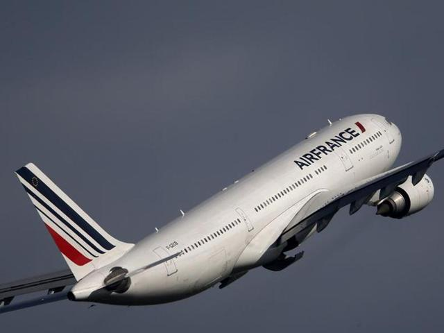 Emergency vehicles are parked near an Air France plane that was diverted to Salt Lake City International Airport, in Salt Lake City in November. A flight from Mauritius to Paris was forced to land in the Kenyan coastal city of Mombasa on Sunday after a device suspected to be a bomb was found in the lavatory.