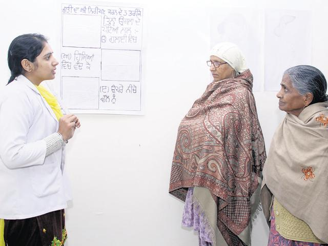 A nurse counsels cancer patients at the Advanced Cancer Diagnostic, Treatment and Research Centre in Batinda, Punjab. There is an unusually high incidence of cancer in the cotton-growing districts of south-western Punjab, which has been linked to the use of pesticides, among other factors.(Sanjeev Kumar/Hindustan Times)
