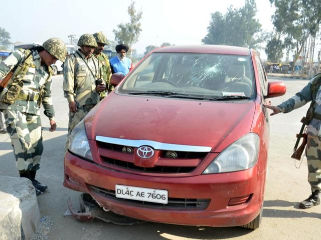 Border Security Force (BSF) personnel inspecting the vehicle in which youngsters from Kashmir were  travelling in Amritsar.