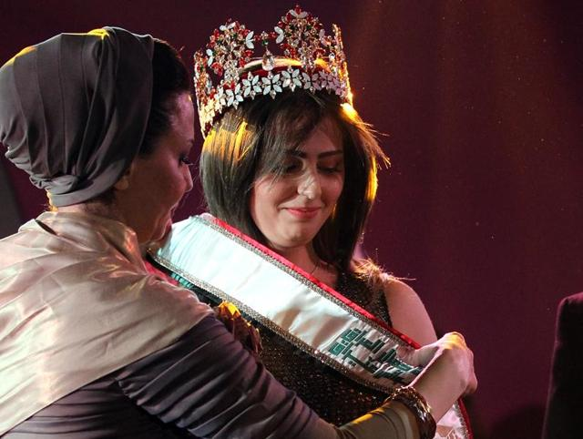 Iraqi Shaymaa Qasim from Kirkuk receives the Miss Iraq sash after winning the beauty contest in the capital Baghdad.