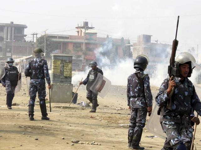 Nepalese policemen use tear gas to disperse ethnic Madhesi protesters in Gaur, a town about 160 kilometers (100 miles) south of Kathmandu. One teenager has been killed and a further dozen injured during fresh clashes between Madhesi protesters and security forces.